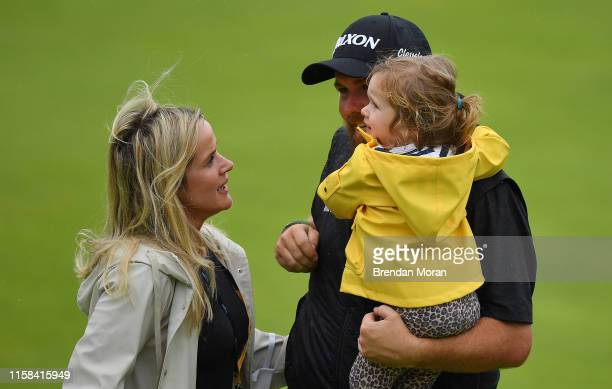 Antrim United Kingdom 21 July 2019 Shane Lowry of Ireland celebrates with his wife Wendy Honner and daughter Iris after winning the Open Championship...