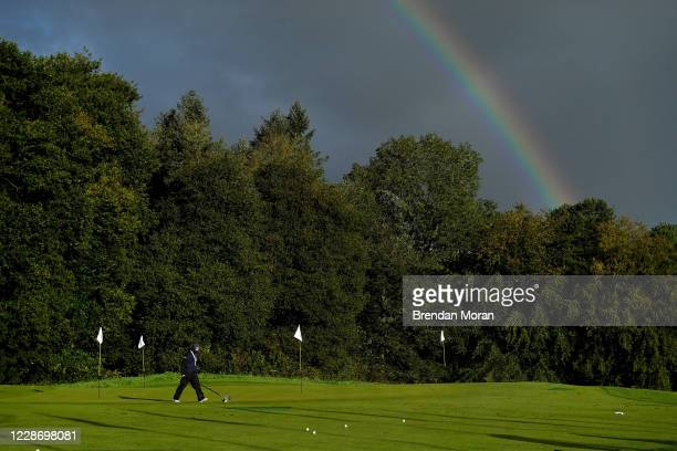 Antrim , United Kingdom - 25 September 2020; A volunteer collects golf balls from the driving range prior to day two of the Dubai Duty Free Irish...