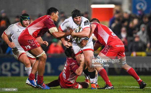 Antrim United Kingdom 29 November 2019 Tom OToole of Ulster is tackled by Sam Lousi and Steve Cummins of Scarlets during the Guinness PRO14 Round 7...