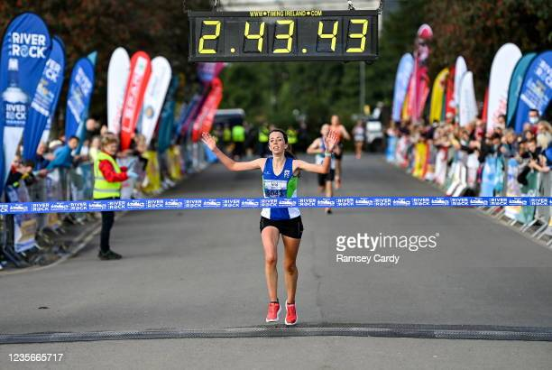 Antrim , United Kingdom - 3 October 2021; Fionnuala Ross of Armagh AC, first female finisher, crosses the line to win the 2021 Deep RiverRock Belfast...