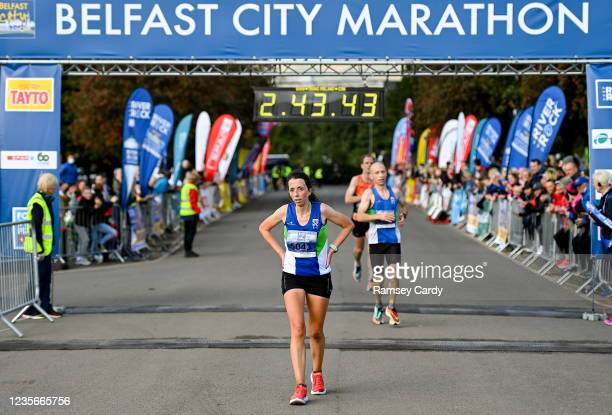 Antrim , United Kingdom - 3 October 2021; Fionnuala Ross of Armagh AC, first female finisher, after crossing the line to win the 2021 Deep RiverRock...