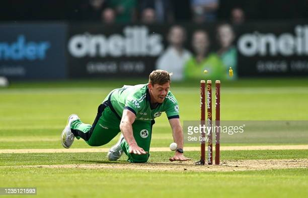 Antrim , United Kingdom - 8 September 2021; Craig Young of Ireland runs-out Luke Jongwe of Zimbabwe during match one of the Dafanews International...