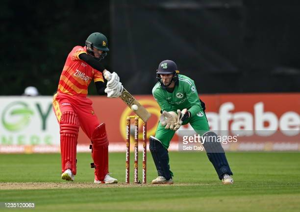 Antrim , United Kingdom - 8 September 2021; Sean Williams of Zimbabwe plays a shot, watched by Ireland wicketkeeper Lorcan Tucker, during match one...