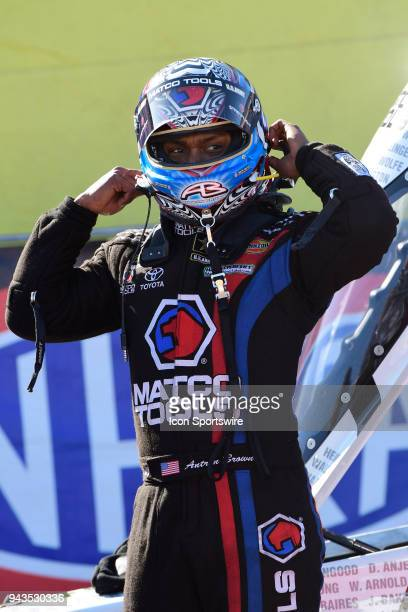 Antron Brown Don Schumacher Racing NHRA Top Fuel Dragster driver prepares to remove his helmet following the final round of eliminations at the 19th...
