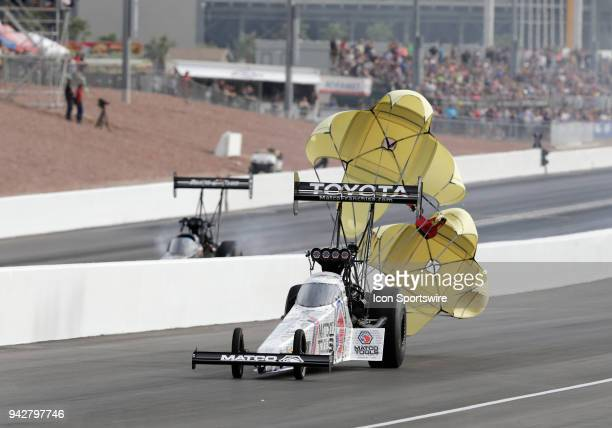 Antron Brown Don Schumacher Racing NHRA Top Fuel Dragster drives up the track with parachutes deployed during the second round of the 19th Annual...