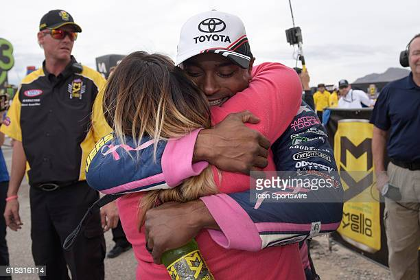 Antron Brown Don Schumacher Racing NHRA Top Fuel Dragster hugs his wife Billie Jo Brown after leaning he had clinched the NHRA Top Fuel championship...