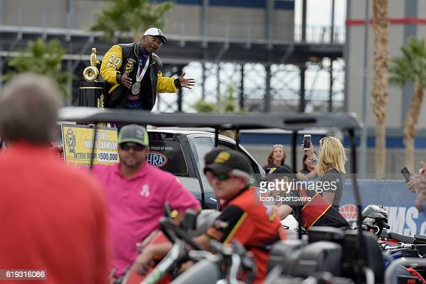 Antron Brown Don Schumacher Racing NHRA Top Fuel Dragster poses for photos after clinching the NHRA Top Fuel championship during the NHRA Toyota...