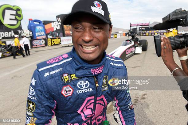 Antron Brown Don Schumacher Racing NHRA Top Fuel Dragster smiles after winning his first run during the NHRA Toyota Nationals Sunday October 30 at...