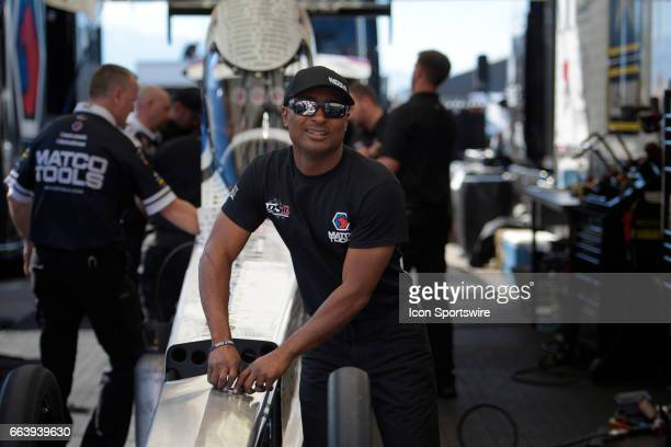 Antron Brown Don Schumacher Racing NHRA Top Fuel Dragster talks to fans while fueling his car during the 18th annual DENSO Spark Plugs NHRA Nationals...