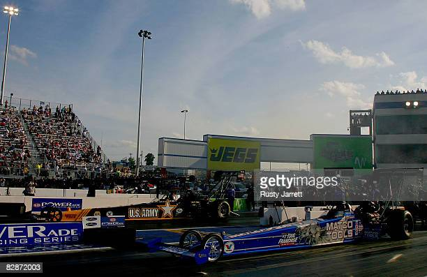 Antron Brown driver of the Matco Tools top fuel dragster lines up against Tony Schumacher driver of the US Army top fuel dragster for the final run...