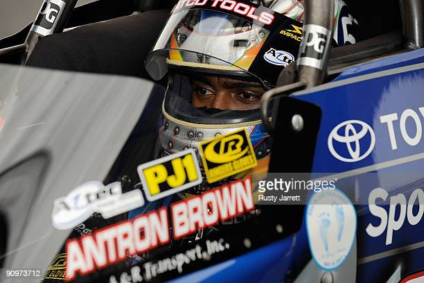 Antron Brown driver of the Matco Tools top fuel dragster prepares to drive during qualifying for the NHRA Carolinas Nationals on September 19 2009 at...