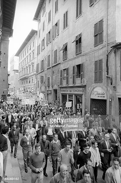 ants at the provincial general strike against rising rent parade through the streets of the city Florence September 19 1969