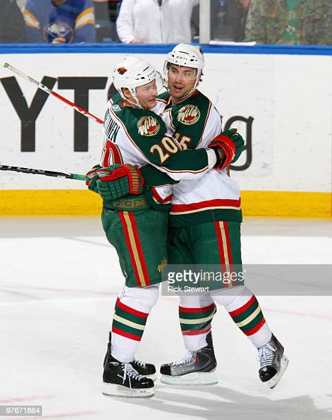 Antti Miettinen and Andrew Brunette of the Minnesota Wild celebrate Brunette's goal in the second period against the Buffalo Sabres at HSBC Arena on...