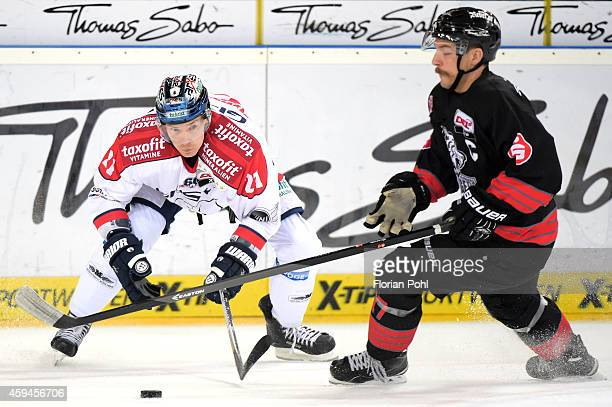 Antti Miettinen of the Eisbaeren Berlin and Patrick Reimer f the Thomas Sabo Ice Tigers Nuernberg duel during the game between Thomas Sabo Ice Tigers...