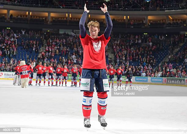 Antti Miettinen of the Eisbaeren Berlin celebrates the win with the fans during the game between Eisbaeren Berlin and ERC Ingolstadt on December 30...