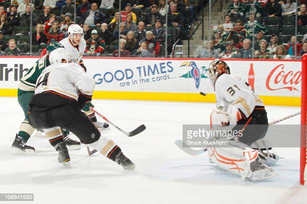 Antti Miettinen of the Minnesota Wild scores the gamewinning goal in overtime against Jonas Hiller and the Anaheim Ducks during the game at the Xcel...