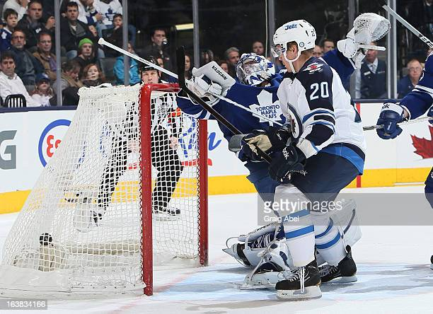 Antti Miettinen of the Winnipeg Jets scores a second period goal on Ben Scrivens of the Toronto Maple Leafs during NHL game action March 16 2013 at...