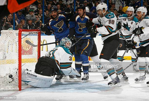 Antti Niemi and Brent Burns of the San Jose Sharks defend the net against Jamie Langenbrunner and BJ Crombeen of the St Louis Blues in Game Five of...