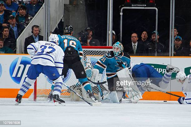 Antti Niemi and Devin Setoguchi of the San Jose Sharks defend against Tim Brent and the Toronto Maple Leafs during an NHL game on January 11, 2011 at...