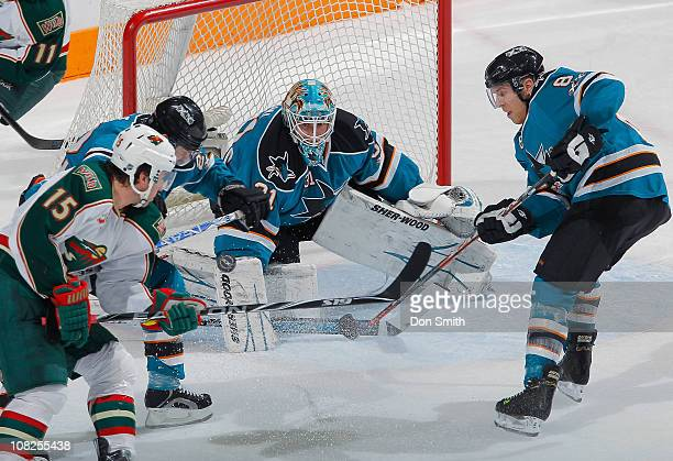 Antti Niemi and Joe Pavelski of the San Jose Sharks defend against Andrew Brunette of the Minnesota Wild during an NHL game on January 22 2011 at HP...