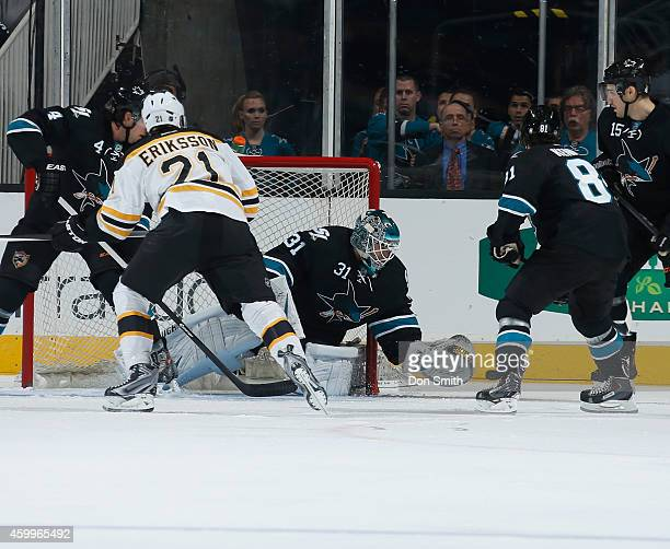 Antti Niemi and Joe Pavelski of the San Jose Sharks protects the net against xx of the Boston Bruins during an NHL game on December 4, 2014 at SAP...