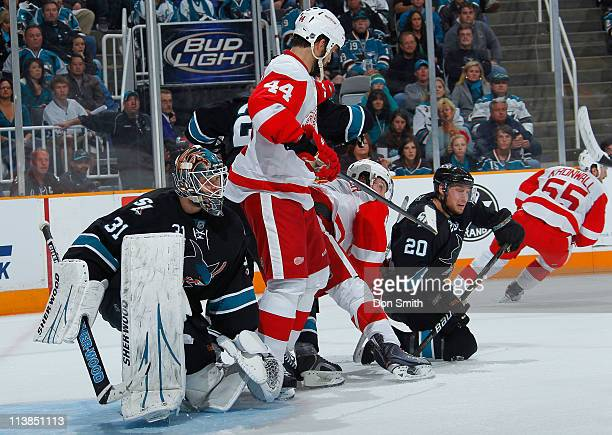 Antti Niemi and Kyle Wellwood of the San Jose Sharks defend the net against Todd Bertuzzi and Niklas Kronwall of the Detroit Red Wings in Game Five...