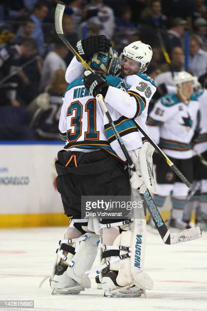 Antti Niemi and Logan Couture of the San Jose Sharks celebrate the Sharks' doubleovertime gamewinning goal against the St Louis Blues during Game One...