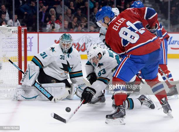 Antti Niemi and Matthew Nieto of the San Jose Sharks protect the net against Lars Eller of the Montreal Canadiens during the NHL game on October 26...