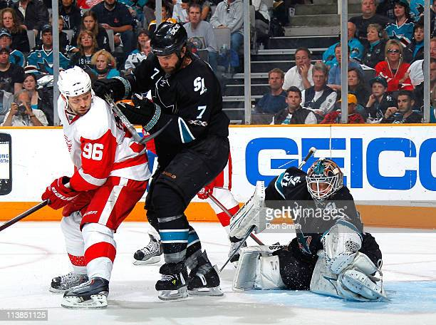 Antti Niemi and Niclas Wallin of the San Jose Sharks fail to keep the puck out of the net against Tomas Holmstrom of the Detroit Red Wings in Game...