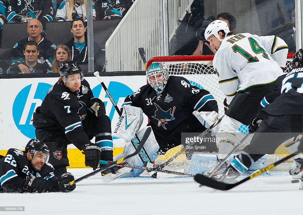 Antti Niemi #31,, Brad Stuart #7 and Dan Boyle #22 of the San Jose Sharks defend the net against Jamie Benn #14 of the Dallas Stars during an NHL game on April 7, 2013 at HP Pavilion in San Jose, California.