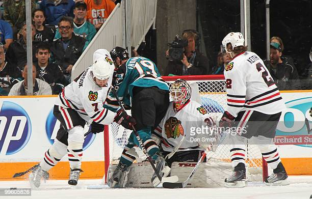 Antti Niemi, Brent Seabrook and Duncan Keith of the Chicago Blackhawks defend the net against Joe Thornton of the San Jose Sharks in Game One of the...