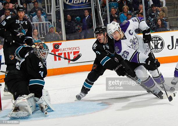 Antti Niemi Ian White and Joe Thornton of the San Jose Sharks protect the net against Dustin Brown of the Los Angeles Kings during an NHL game on...