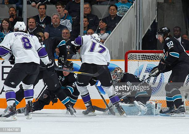 Antti Niemi Jason Demers Logan Couture and Dany Heatley of the San Jose Sharks protect the net against Drew Doughty and Wayne Simmonds of the Los...