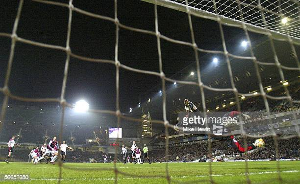 Antti Niemi of Fulham fails to stop Anton Ferdinand of West Ham United scoring their first goal during the Barclays Premiership match between West...