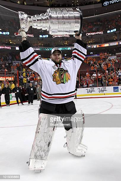 Antti Niemi of the Chicago Blackhawks hoists the Stanley Cup after teammate Patrick Kane scored the gamewinning goal in overtime to defeat the...