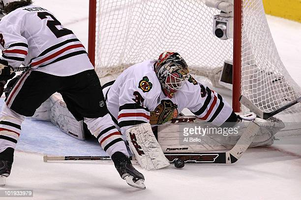 Antti Niemi of the Chicago Blackhawks makes a save in front of teammate Duncan Keith against the Philadelphia Flyers in Game Six of the 2010 NHL...
