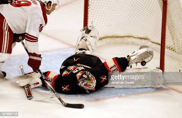 Antti Niemi of the Chicago Blackhawks makes a save in third period in front of Shane Doan of the Phoenix Coyotes on his way to a shutout at the...