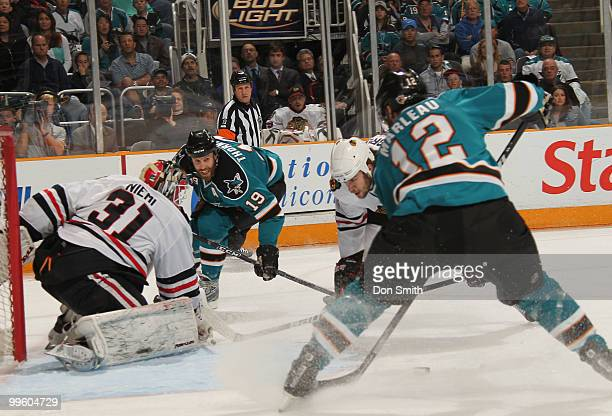 Antti Niemi of the Chicago Blackhawks watches Joe Thornton and Patrick Marleau of the San Jose Sharks in Game One of the Western Conference Finals...