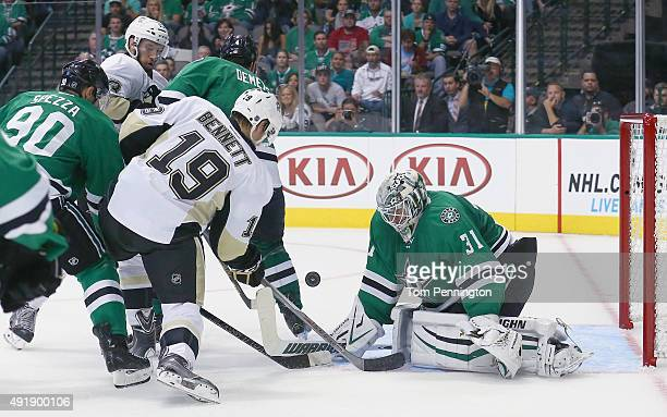 Antti Niemi of the Dallas Stars blocks a shot by Beau Bennett of the Pittsburgh Penguins in the second period at American Airlines Center on October...