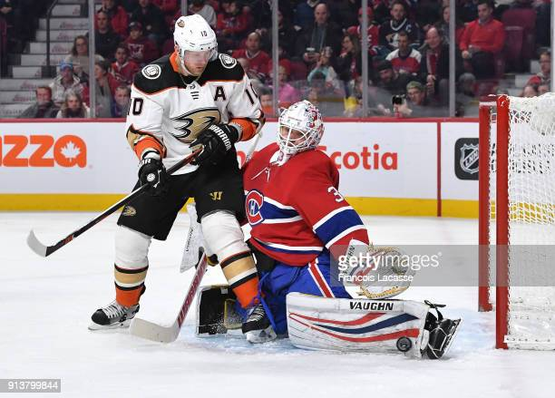 Antti Niemi of the Montreal Canadiens makes a kick save in front of Corey Perry of the Anaheim Ducks in the NHL game at the Bell Centre on February 3...