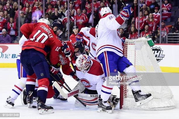 Antti Niemi of the Montreal Canadiens makes a save as Tomas Plekanec battles for the puck against Brett Connolly of the Washington Capitals in the...