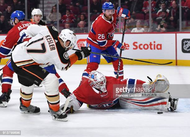 Antti Niemi of the Montreal Canadiens makes a save off the shot by Ryan Kesler of the Anaheim Ducks in the NHL game at the Bell Centre on February 3...