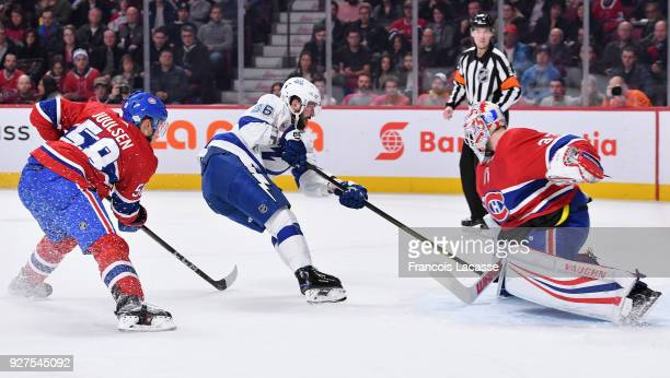 Antti Niemi of the Montreal Canadiens stops a shot by Nikita Kucherov of the Tampa Bay Lightning in the NHL game at the Bell Centre on February 24...