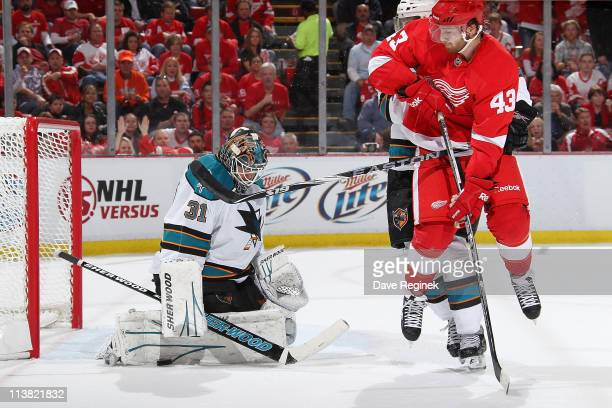 Antti Niemi of the San Jos Sharks makes a save on Darren Helm of the Detroit Red Wings in Game Four of the Western Conference Semifinals in the 2011...