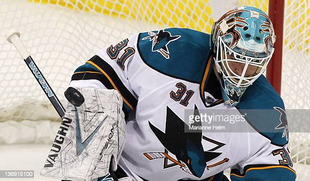 Antti Niemi of the San Jose Sharks blocks a shot on goal in a game against the Winnipeg Jets in NHL action at the MTS Centre on January 12 2012 in...