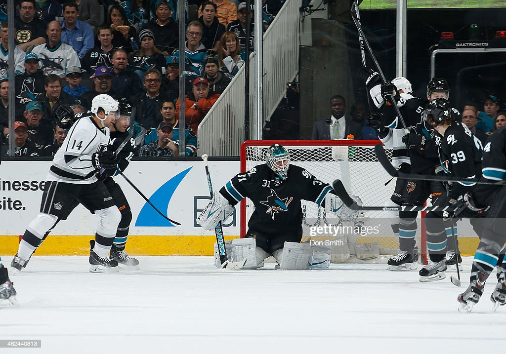 Antti Niemi #31 of the San Jose Sharks defends the net against Justin Williiams #14 of the Los Angeles Kings during an NHL game on April 3, 2014 at SAP Center in San Jose, California.