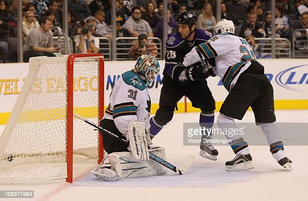 Antti Niemi of the San Jose Sharks fails to make a save on a shot by Ryan Smyth of the Los Angeles Kings as Jarret Stoll watches the puck enter the...