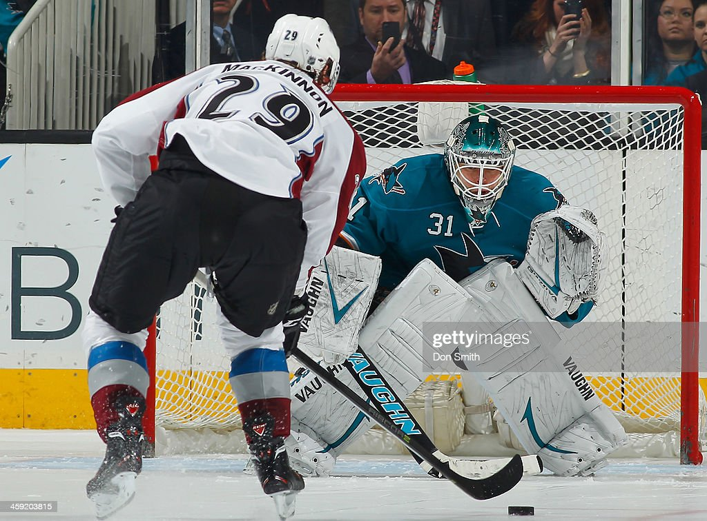 Antti Niemi #31 of the San Jose Sharks gets in position for a shot against Nathan MacKinnon #29 of the Colorado Avalanche during an NHL game on December 23, 2013 at SAP Center in San Jose, California.