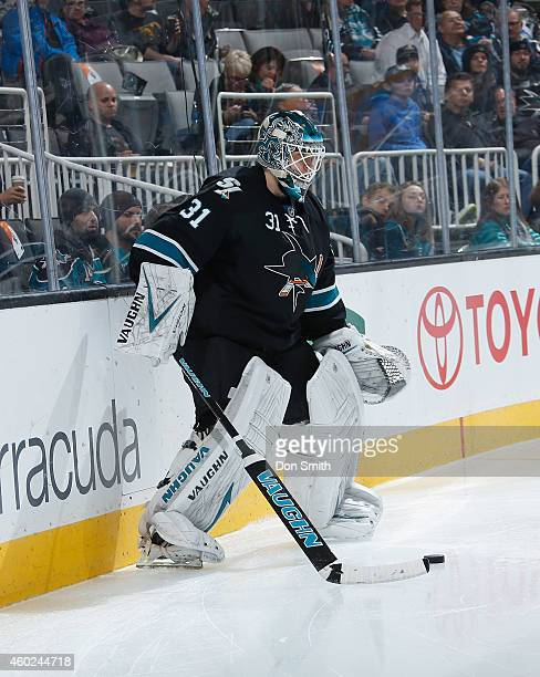 Antti Niemi of the San Jose Sharks handles the puck against the Boston Bruins during an NHL game on December 4, 2014 at SAP Center in San Jose,...