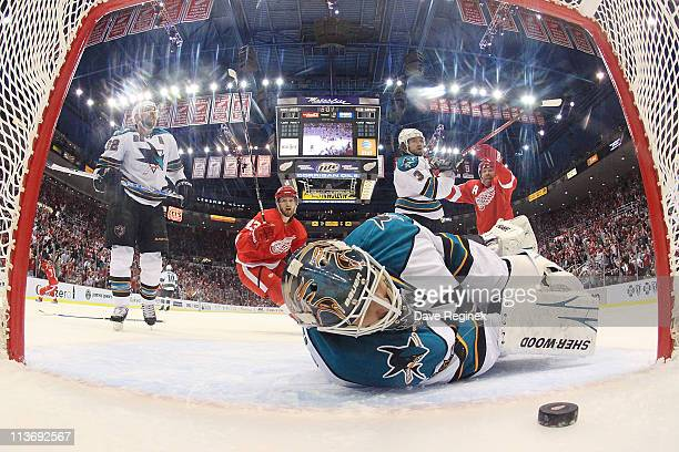 Antti Niemi of the San Jose Sharks looks at a goal scored by Patrick Eaves of the Detroit Red Wings in Game Three of the Western Conference...
